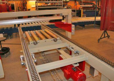 Kædebane med indbygget rullebane og pneumatisk tværskub